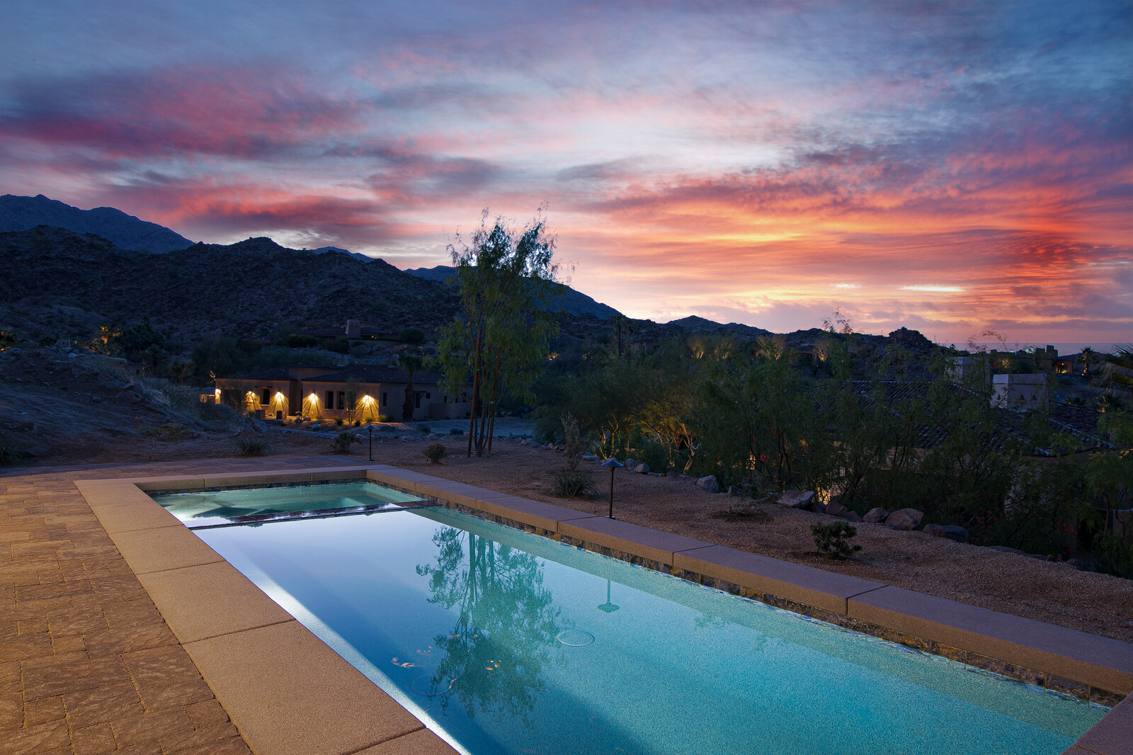 Stone Eagle home pool facing mountains